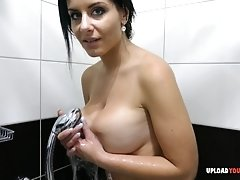 Very Busty young girl takes a nice shower on camera